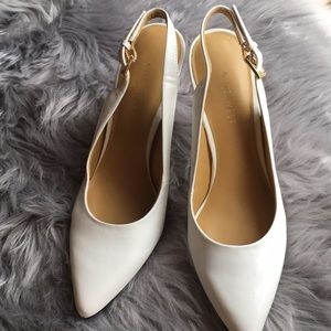 White open heeled shoes in size 7
